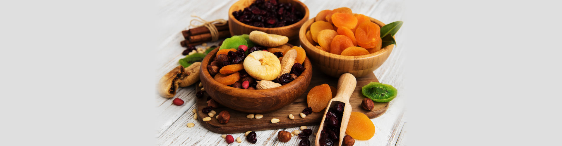 mixed dried fruits on a old white wooden table